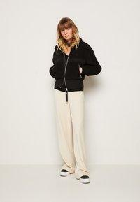 Calvin Klein Jeans - POLAR SHORT JACKET - Winter jacket - black - 1