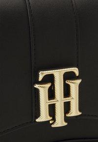Tommy Hilfiger - LOCK CROSSOVER - Across body bag - black - 0