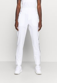 Lacoste Sport - OLYMP TRACK PANT - Tracksuit bottoms - white/navy blue - 0