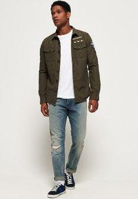 Superdry - DAMAN - Straight leg jeans - grey - 1