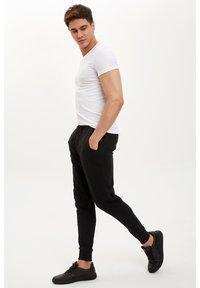 DeFacto - DEFACTO TRACKSUIT BOTTOMS - Spodnie treningowe - black - 3