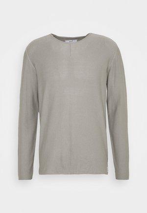 Stickad tröja - stone grey