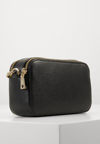 DKNY - BRYANT CAMERA BAG SUTTON - Across body bag - black/gold-coloured - 2