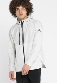 adidas Performance - URBAN - Cortaviento - raw white - 0