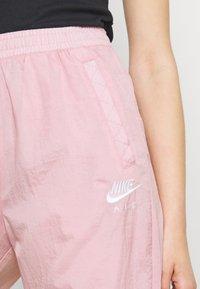 Nike Sportswear - AIR PANT - Pantalones deportivos - pink glaze/white - 3