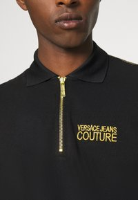 Versace Jeans Couture - ZIP - Polo shirt - nero - 5