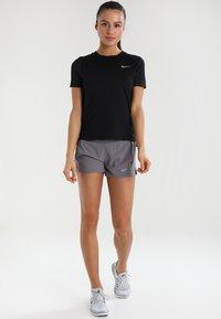 Nike Performance - DRY MILER - Basic T-shirt - black/reflective silver - 1