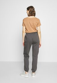 Nly by Nelly - COZY PANTS - Tracksuit bottoms - off black - 2