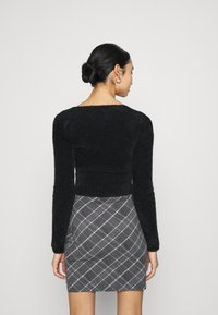 BDG Urban Outfitters - FLUFF BALET WRAP - Trui - black - 2