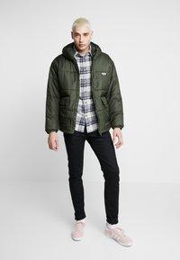 adidas Originals - REVEAL YOUR VOICE JACKET - Winter jacket - night cargo - 1
