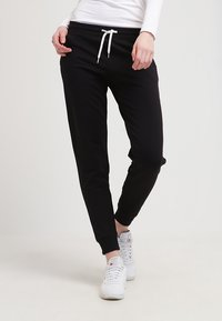 Zalando Essentials - Tracksuit bottoms - black - 0