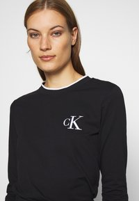 Calvin Klein Jeans - EMBROIDERY TIPPING - Long sleeved top - black - 4
