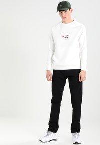 Carhartt WIP - KLONDIKE PANT MAITLAND - Straight leg jeans - black rinsed - 1