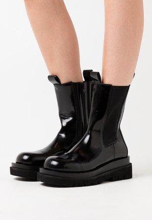 TANKED PAVEMENT X JEFFREY CAMPBELL - Platform ankle boots - black