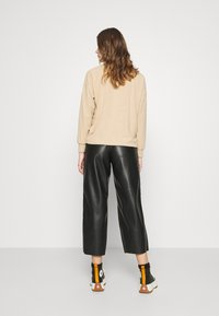 Vila - VIPEN CROPPED COATED PANTS  - Trousers - black - 2