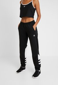 adidas Originals - LARGE LOGO ADICOLOR SPORT PANTS - Pantalones deportivos - black/white - 0