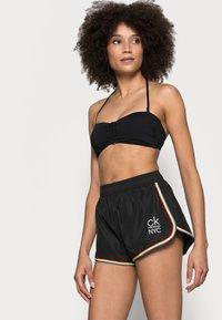 Calvin Klein Swimwear - PRIDE EDIT - Spodní díl bikin - black - 3