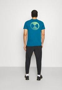 Nike Performance - PANT YOGA - Teplákové kalhoty - black/iron grey - 2