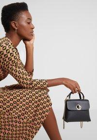 kate spade new york - MINI TOP HANDLE - Handbag - black - 1