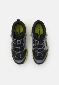adidas Performance - TERREX MID GTX UNISEX - Hiking shoes - core black/grey three/acid yellow - 3