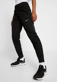 Nike Performance - SHIELD PROTECT PANT - Joggebukse - black/silver
