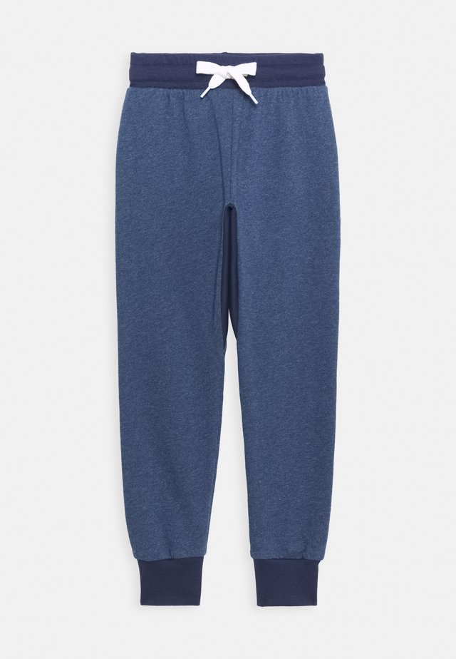 UNISEX - Tracksuit bottoms - denim