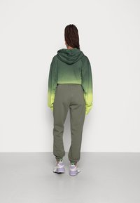 Gina Tricot - BASIC SWEATPANTS - Tracksuit bottoms - beetle - 2