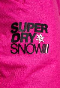 Superdry - Ski- & snowboardbukser - luminous pink - 8