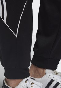 adidas Originals - BIG TREFOIL ABSTRACT POLYESTER TRACKSUIT BOTTOM - Tracksuit bottoms - black - 5