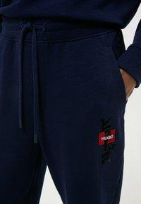HUGO - DOHAGI - Tracksuit bottoms - dark blue - 3
