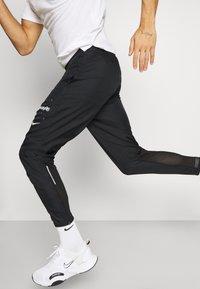 Nike Performance - PANT - Pantalon de survêtement - black - 3