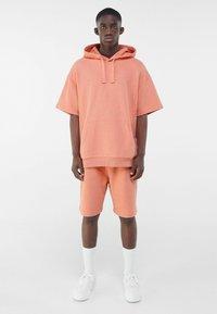 Bershka - Print T-shirt - orange - 1