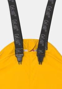 CeLaVi - OVERALL SOLID UNISEX - Kalhoty do deště - yellow - 2