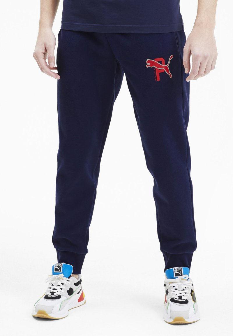 Puma - ATHLETICS - Tracksuit bottoms - peacoat