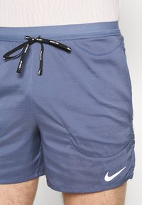 Nike Performance - FLEX STRIDE - Sports shorts - diffused blue/reflective silver - 3