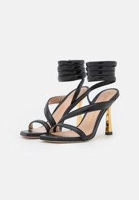 Stuart Weitzman - BEATRIX WRAP - Sandals - black/gold - 2