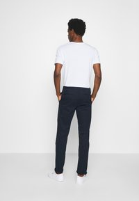 Tommy Hilfiger Tailored - FLEX SLIM FIT PANT - Trousers - blue