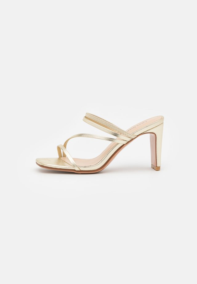 Heeled mules - light gold