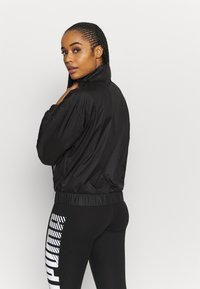 Puma - TRAIN LOGO QUARTER  - Training jacket - puma black - 2