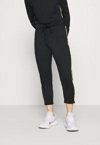 ONLY PLAY Petite - ONPADOR PANTS  - Pantalones deportivos - black - 0