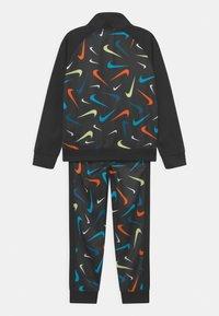 Nike Sportswear - PRINT SET UNISEX - Training jacket - black - 1