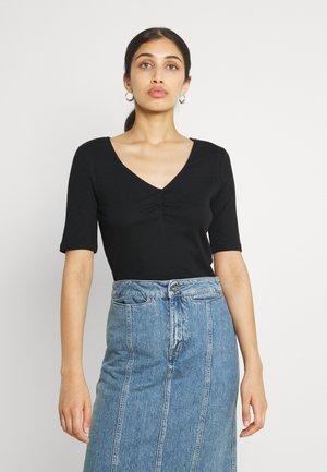 VIFELIA - T-shirt - bas - black