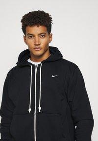 Nike Performance - ISSUE HOODIE - Zip-up sweatshirt - black/pale ivory - 4