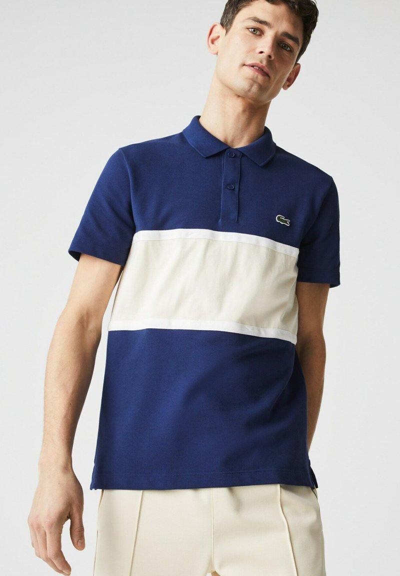 Lacoste - Polo shirt - bleu/beige