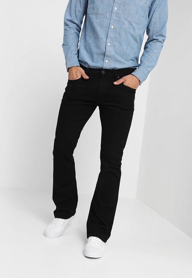 TRENTON - Bootcut jeans - black rinse