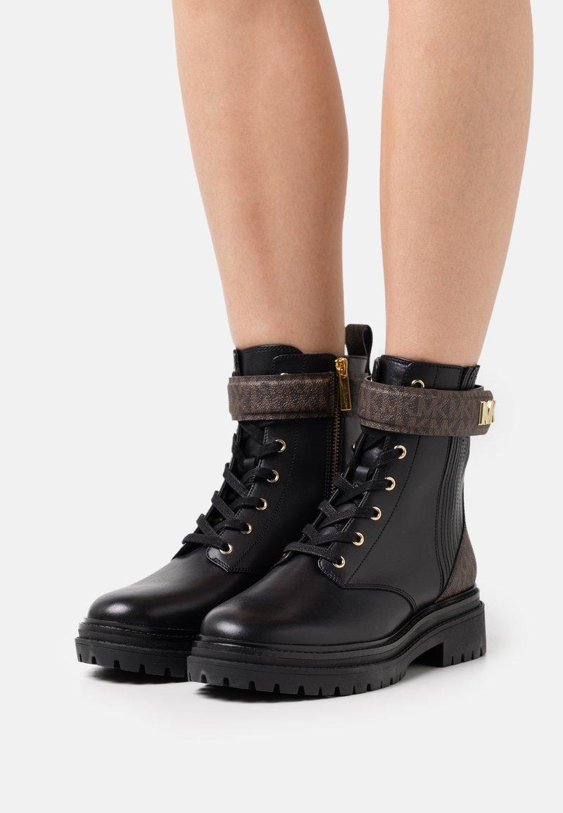 MICHAEL Michael Kors - STARK BOOTIE - Lace-up ankle boots - black/brown