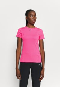 Nike Performance - ALL OVER - Basic T-shirt - hyper pink/white - 0