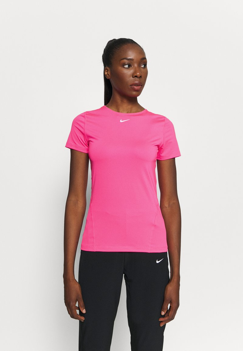 Nike Performance - ALL OVER - Basic T-shirt - hyper pink/white