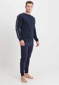 Tommy Hilfiger - TRACK TOP - Pyjama top - blue - 1