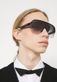 Alexander McQueen - UNISEX - Sunglasses - black/grey - 1